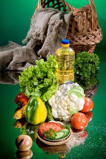 Oil, Basket And Vegetables