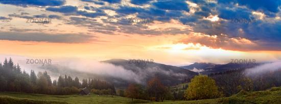 Daybreak in autumn mountain