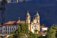 Ancient historical catholic church and hills in downtow of Ouro Preto city