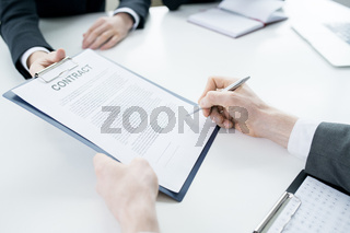 Unrecognizable Businessman Signing Contract