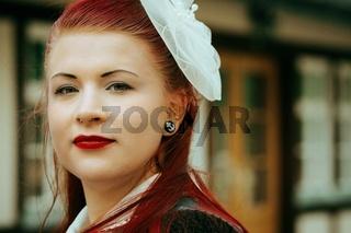 aged portrait of a stylish redhead woman