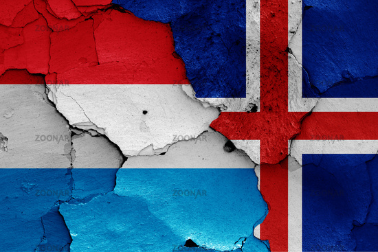 flags of Luxembourg and Iceland painted on cracked wall