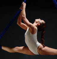 Sexy girl in white body on aerial silks