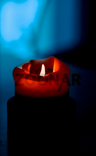 Red holiday candle on dark background, luxury branding design and decoration for Christmas, New Years Eve and Valentines Day