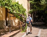 Photographer walks through the gardens in Salamanca Spain