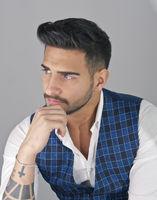 Trendy young man in studio shot wearing elegant vest