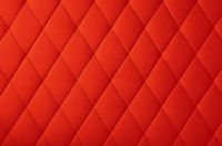 Red leather upholstery background texture