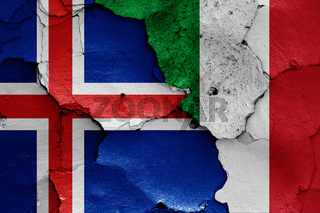 flags of Iceland and Italy painted on cracked wall