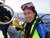 young pretty female scuba diver making victory sign