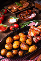 Rustic dates wrapped in bacon and young roasted potato.