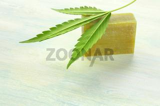 Cannabis soap bar with a cannabis leaf and copy space