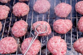 Grilling meatballs on the grill. Cooking  barbeque with charcoal in garden.