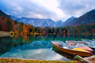 Alpine lake and colorful boats, Lake Fusine,Italy