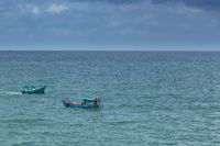 Two fishing boats crossing each off the waters of the Gulf of Thailand