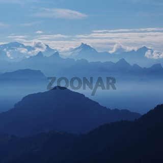Mountain ranges in Switzerland at sunrise. Distant view of Mount Santis.