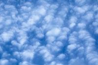 Puffy Cirrocumulus clouds against blue sky