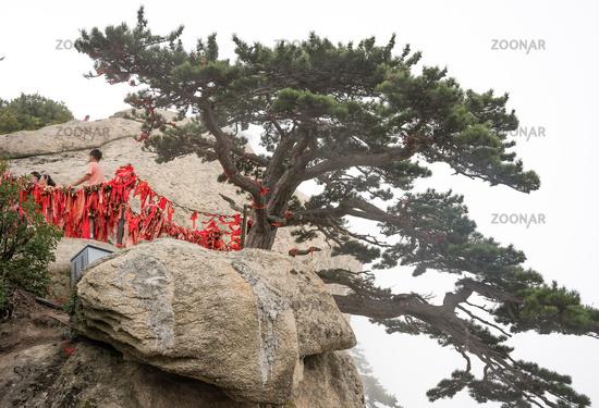 People on the edge at West Peak in Huashan mountain