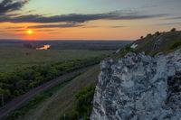 Sunset above green valley in Divnogorye