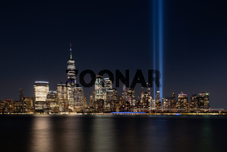 Jersey City, NJ - USA - Aug 30 2019: The 9/11 Tribute in Lights temporary monument in lower Manhattan New York City view from New Jersey