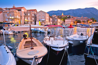 Town of Korcula coastline and harbor colorful dusk view,