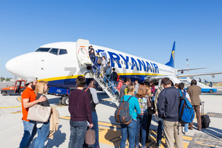 Trieste airport, Italy - 20 April 2018: People boarding Ryanair plane on Friuli Venezia Giulia Airport in Trieste, italy on April 20th, 2018. Ryanair is the biggest low-cost airline company in Europe