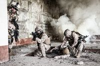 Squad of US marines in action in ruined building