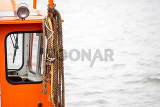 Close-up, ropes hang on a boat cabin