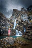 Moody skies, limestone cliffs, waterfalls and blue waterholes
