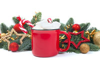 Cocoa mug and baubles on white