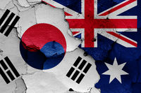 flags of South Korea and Australia painted on cracked wall