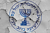 flag of Mossad painted on cracked wall