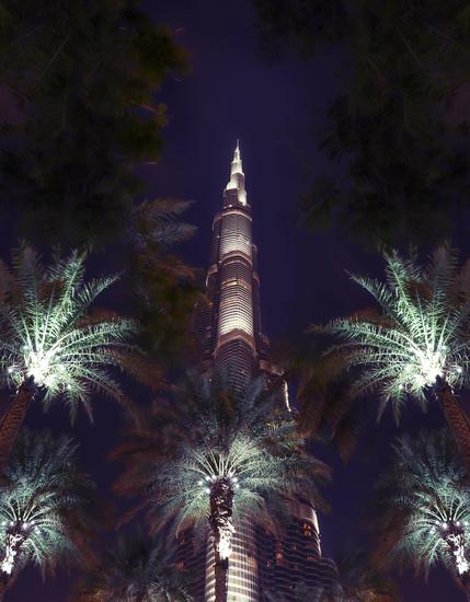 Dubai, UAE December 25/2018 Urbanistic backdrop. Holiday uae night background. Futuristic skyline. United arab emirates night sky. Famous landmark.