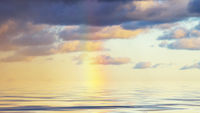 Rainbow over the sea in Denmark in the afternoon