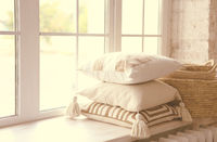 Windowsill with light pillows