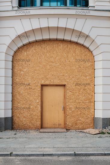 Temporary entrance door , wooden door on beautiful building -