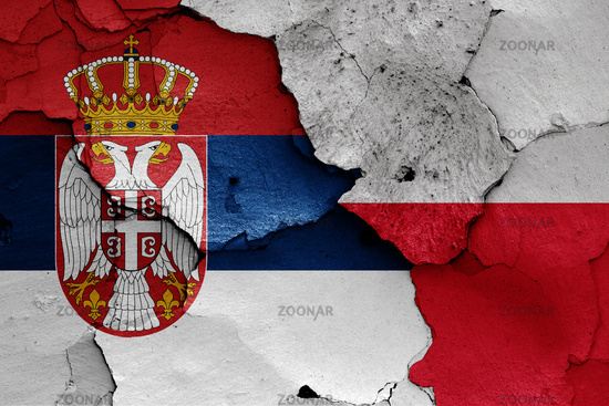 flags of Serbia and Poland painted on cracked wall