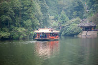 Boat transporting chinese tourists on a lake