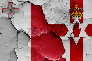 flags of Malta and Northern Ireland painted on cracked wall