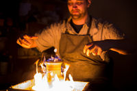 Burning ceramic jug on pottery wheel