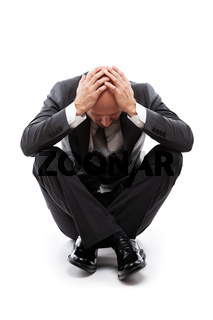 Crying tired or stressed businessman in depression hand hiding face