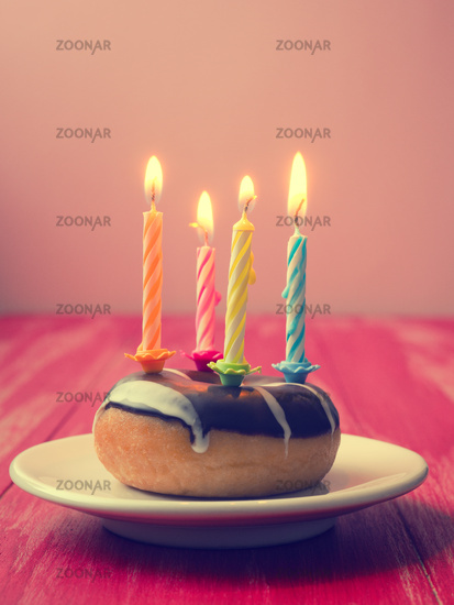 Birthday candles on a donut