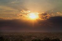 Misty sunset over the Ukrainian town of Mukachevo