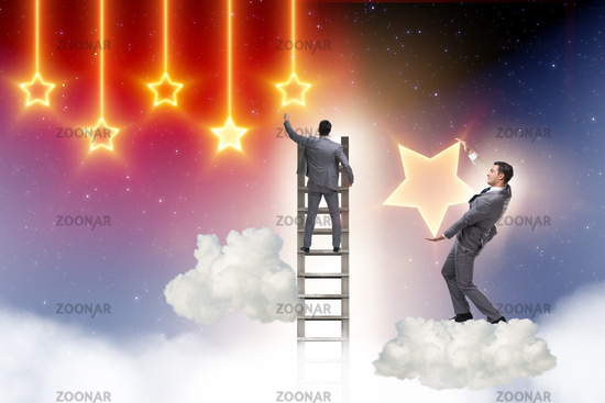 Businessman reaching out for stars
