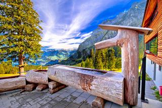 Wooden fountain below Pilatus mountain view