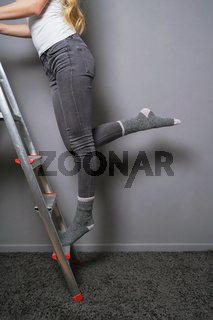 climbing ladder in socks household accident risk