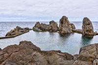 Natural lava rock pool and sea in Porto Moniz in Madeira