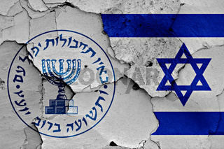 flags of Mossad and Israel painted on cracked wall