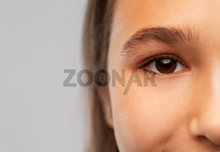 close up of teenage girl face with brown eyes