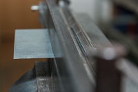 Bending sheet metal with bending machine - closeup metalworking
