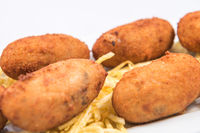 Homemade croquettes and French fries